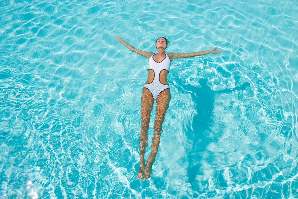 floating in swimming pool